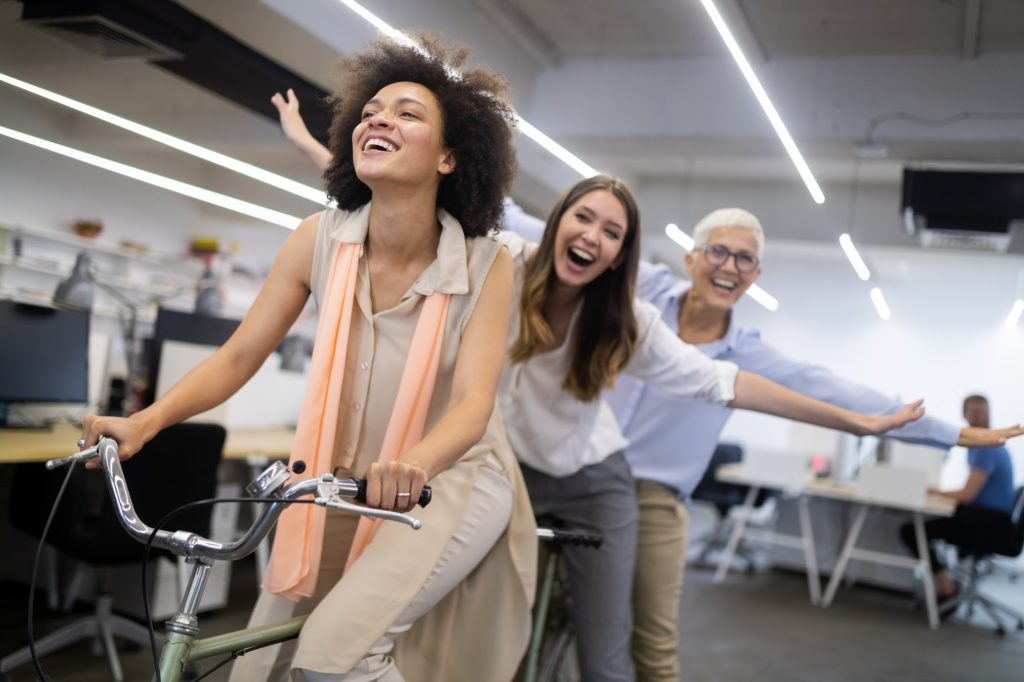 Carefree diverse office workers having fun during work break